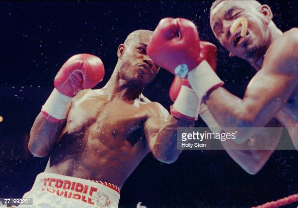 Terrible Terry Norris lands a left hand punch onto the jaw of Carl Daniels and knocking his mouth guard protector out during their World Boxing...