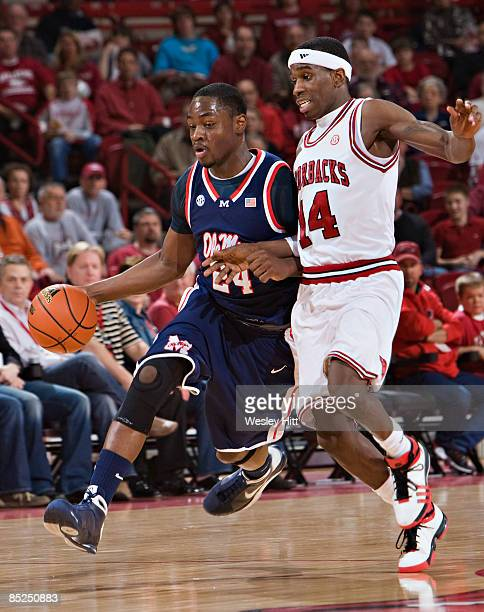 Terrico White of the Ole Miss Rebels dribbles past Stefan Welsh of the Arkansas Razorbacks at Bud Walton Arena on March 4, 2009 in Fayetteville,...
