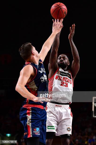 Terrico White of the Perth Wildcats shoots over Daniel Johnson of the Adelaide 36ers during the round 14 NBL match between the Adelaide 36ers and the...