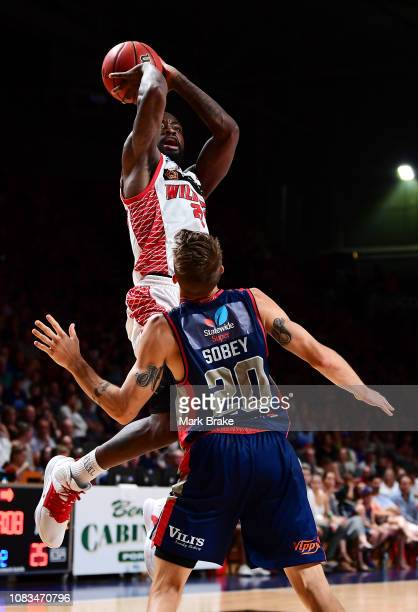 Terrico White of the Perth Wildcats shoots over Nathan Sobey of the Adelaide 36ers during the round 14 NBL match between the Adelaide 36ers and the...