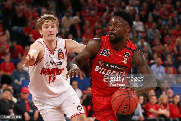 Terrico White of the Wildcats drives to the basket against Daniel Grida of the Hawks during the round one NBL match between the Perth Wildcats and...