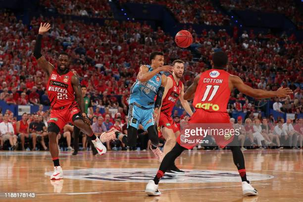 Terrico White of the Wildcats lands awkwardly after a contest for the ball against RJ Hampton of the Breakers during the round seven NBL match...