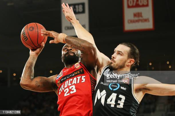Terrico White of the Wildcats shoots the ball past Chris Goulding of United during game two of the NBL Grand Final Series between Melbourne United...