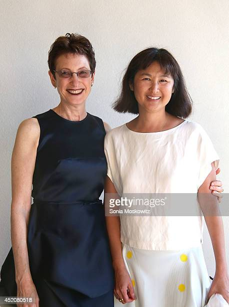 Terrie Sultan and Maya Lin attend the 2014 Parrish Art Museum Midsummer Party at Parrish Art Museum on July 12 2014 in Southampton New York