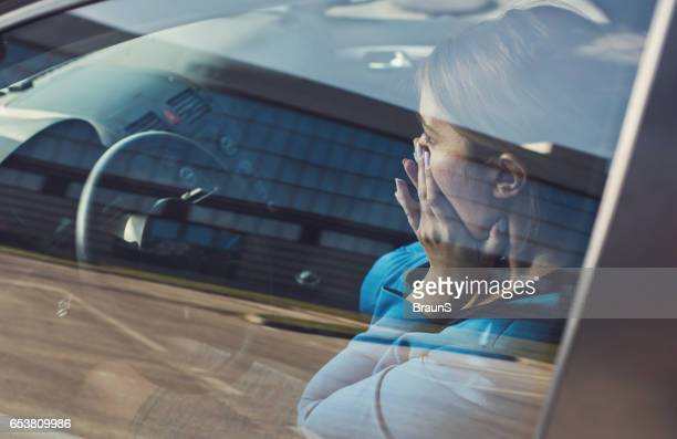 terrified businesswoman in the car during business trip. - terrified stock pictures, royalty-free photos & images