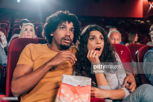 terrified couple at cinema - horror movie stock pictures, royalty-free photos & images