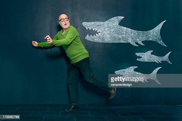 Terrified man escaping from sharks