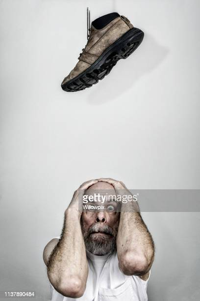 terrified senior adult man waiting for the other shoe to drop - bad luck stock pictures, royalty-free photos & images