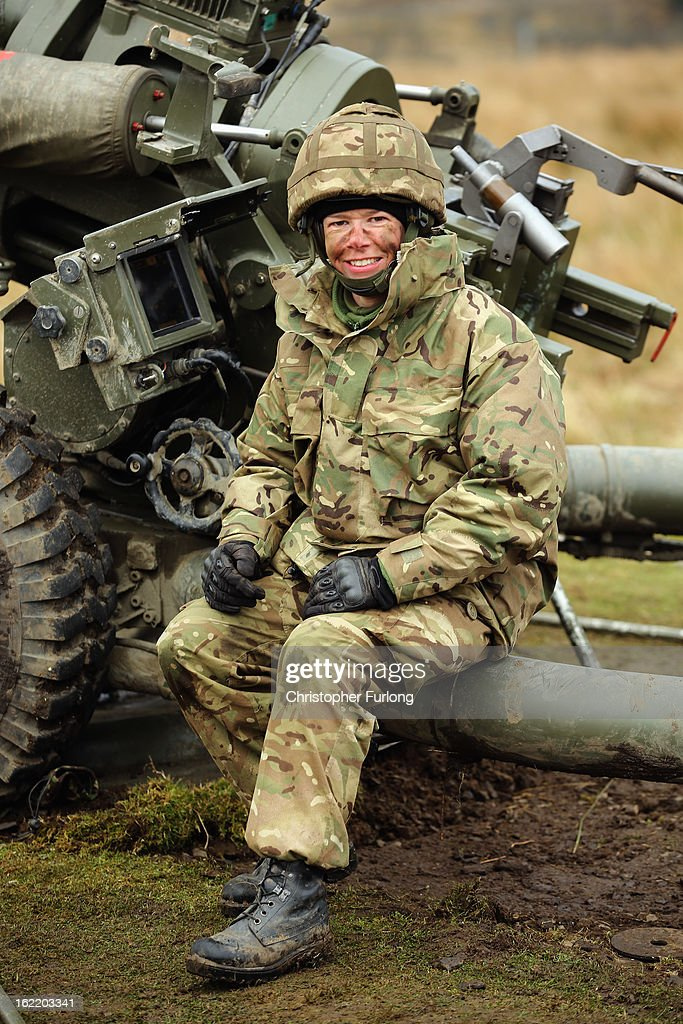 Territorial Army gunner Louisa Smith of the Royal Artillery sits next to her 105mm cannon during an exercise on February 20, 2013 in Otterburn, United Kingdom. Artillery units from Brtain and France are taking part in an intensive training exercise for Regular and Reserve Army units preparing for Afghanistan at the Otterburn training area in Northumberland. French Fire Support Teams, who work alongside their infantry units calling in artillery support, are learning to work with the Royal Artillery for future combat.