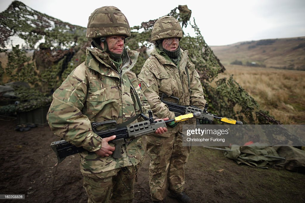Territorial Army gunners Louisa Smith (L) and Vicky Shepherd of the Royal Artillery prepare to fire their 105mm cannon during an exercise on February 20, 2013 in Otterburn, United Kingdom. Artillery units from Brtain and France are taking part in an intensive training exercise for Regular and Reserve Army units preparing for Afghanistan at the Otterburn training area in Northumberland. French Fire Support Teams, who work alongside their infantry units calling in artillery support, are learning to work with the Royal Artillery for future combat.
