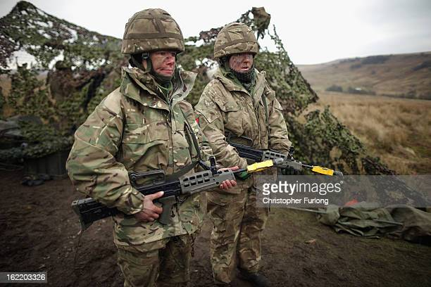 Territorial Army gunners Louisa Smith and Vicky Shepherd of the Royal Artillery prepare to fire their 105mm cannon during an exercise on February 20...