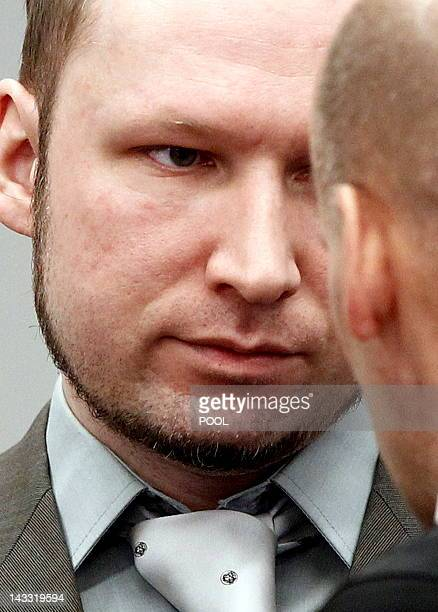 Terror and murder charged Anders Behring Breivik confers with his defence lawyer Geir Lippestad in the courtroom in Oslo on April 24 2012 Lise Aserud...