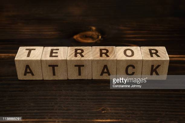 terror attack words on wooden blocks - johnny sins stock pictures, royalty-free photos & images