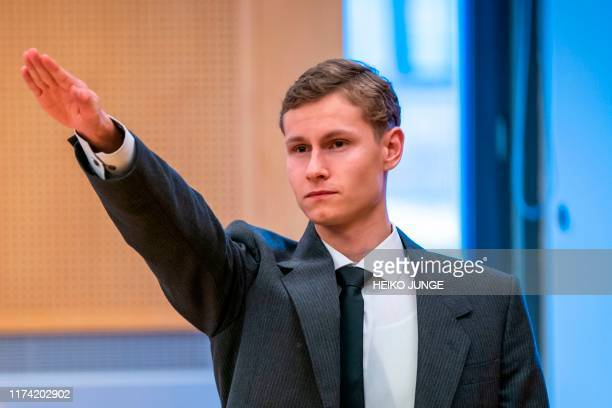 TOPSHOT Terror charged Philip Manshaus gives a Nazi salute as he appears for his hearing at a courthouse in Oslo on 7 October 2019 / Norway OUT