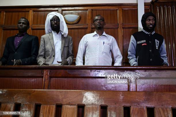 TOPSHOT Terror suspects Osman Abdi Dagane Sahal Diriye Hassan Aden Hassan and Mohamed Ali Abdikar stand in the dock charged with carrying out a...