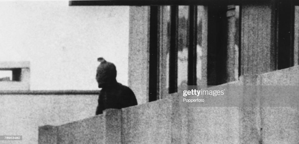 "Terrorism. 1972 Olympic Games in Munich. pic: September 1972. An Arab guerilla of the ""Black September"" movement on a balcony waering a hooded face mask. : News Photo"