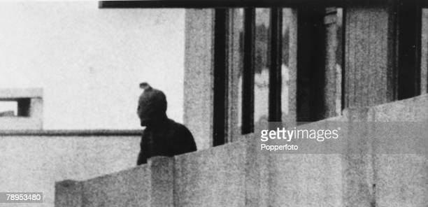 Terrorism 1972 Olympic Games in Munich pic September 1972 An Arab guerilla of the Black September movement on a balcony waering a hooded face mask