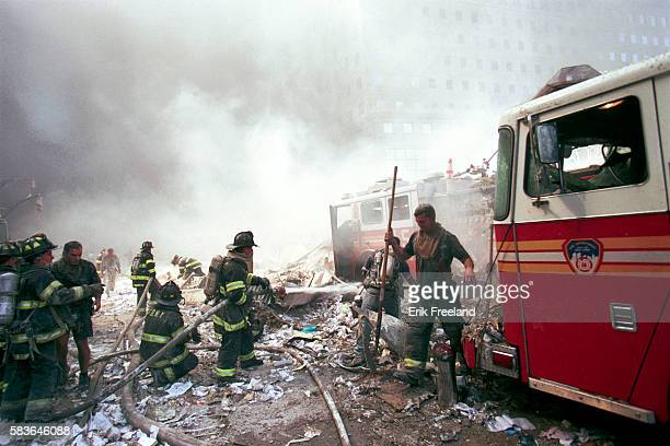 Terrorist attack on World Trade Center. Firefighters in the rubble. --- Photo by Erik Freeland/Corbis Saba