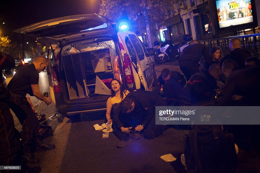 terrorist attacks in Paris at the Bataclan concert hall, in the streets and pubs of the 11th district on November 13, 2015. Police officers and paramedics take care of the wounded after a shooting attack in the Bataclan music hall.