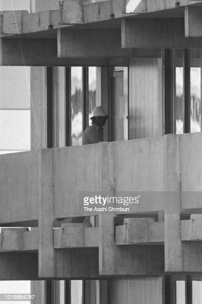 Terrorist group 'Black September' member checks outside after taking hostages at the residence of the Israeli athletes at the Athletes' Village...