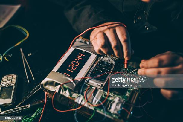 terrorist making a time bomb - detonator stock photos and pictures