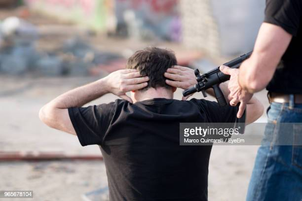 terrorist with hostage on ground - victim stock pictures, royalty-free photos & images