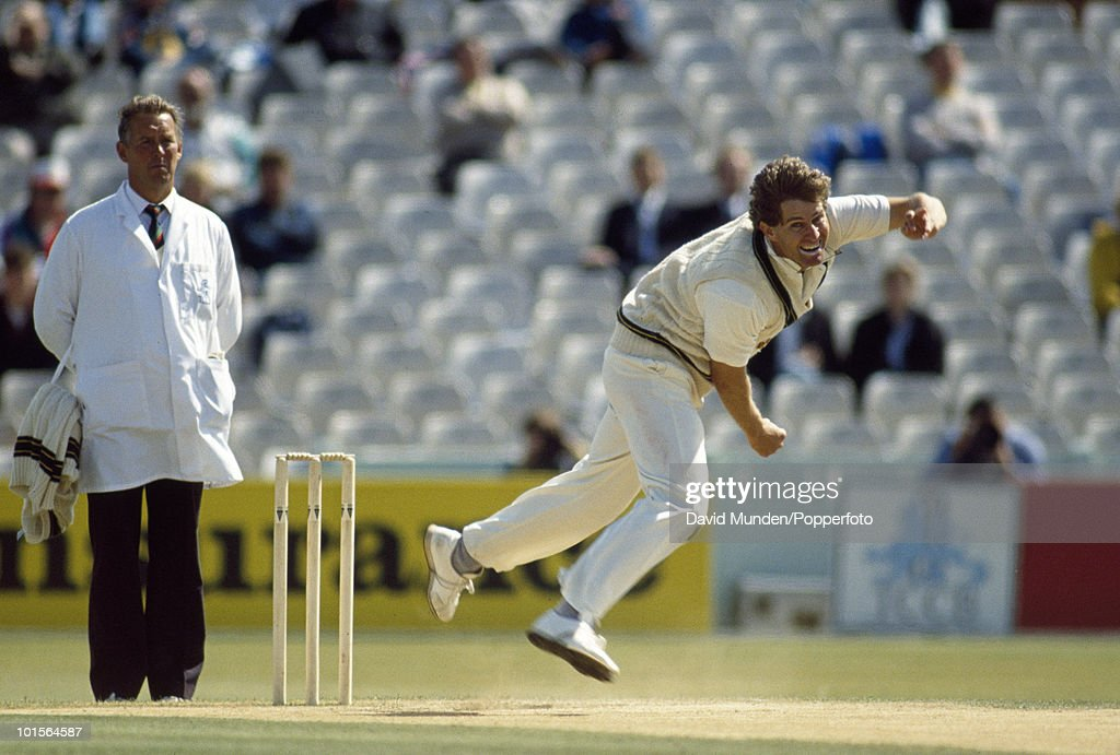 Terry Alderman bowling for Australia on the fifth day of the 4th Test match between England and Australia at Old Trafford in Manchester, 1st August 1989. The umpire is John Hampshire. Australia won by 9 wickets.