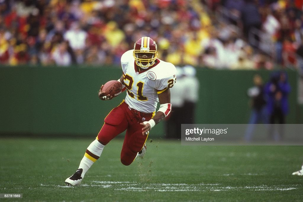 Terry Allen #21 of the Washington Redskins runs with the ball during a NFL football game against the St. Louis Rams at Jack Kent Cooke Stadium on November 30, 1997 in Landover, Maryland.
