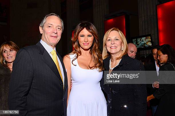 Terry and Sandy Brucker pose with Melania Trump at The Philadelphia Style Magazine cover event hosted by Melania Trump at Ritz Carlton Hotel on...
