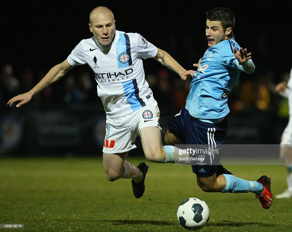 Terry Antonis of Sydney FC and Aaron Mooy of City compete for the ball during the FFA Cup match between Melbourne City and Sydney FC at Morshead Park Stadium on August 12, 2014 in Ballarat, Australia.
