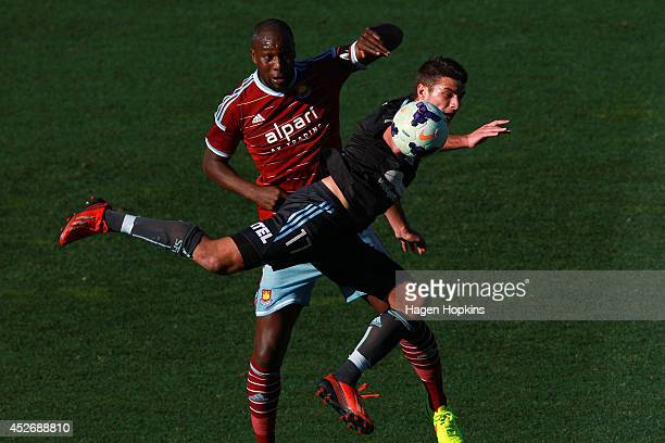 Terry Antonis of Sydney FC and Carlton Cole of West Ham United compete for a header during the Football United New Zealand Tour 2014 match between...