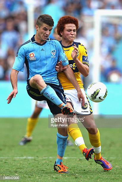 Terry Antonis of Sydney FC competes for the ball against Mustafa Amini of the Mariners during the round 14 ALeague match between Sydney FC and the...