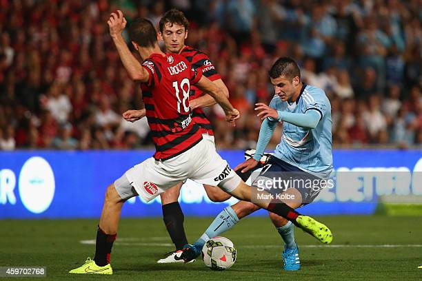 Terry Antonis of Sydney FC controls the ball under pressure from Iacopo la Rocca of the Wanderers during the round eight ALeague match between...