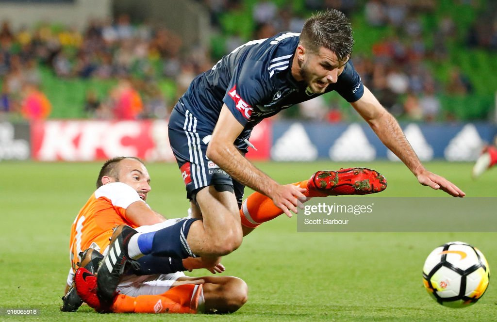 Terry Antonis of the Victory and Ivan Franjic of the Roar compete for the ball during the round 20 A-League match between the Melbourne Victory and the Brisbane Roar at AAMI Park on February 9, 2018 in Melbourne, Australia.