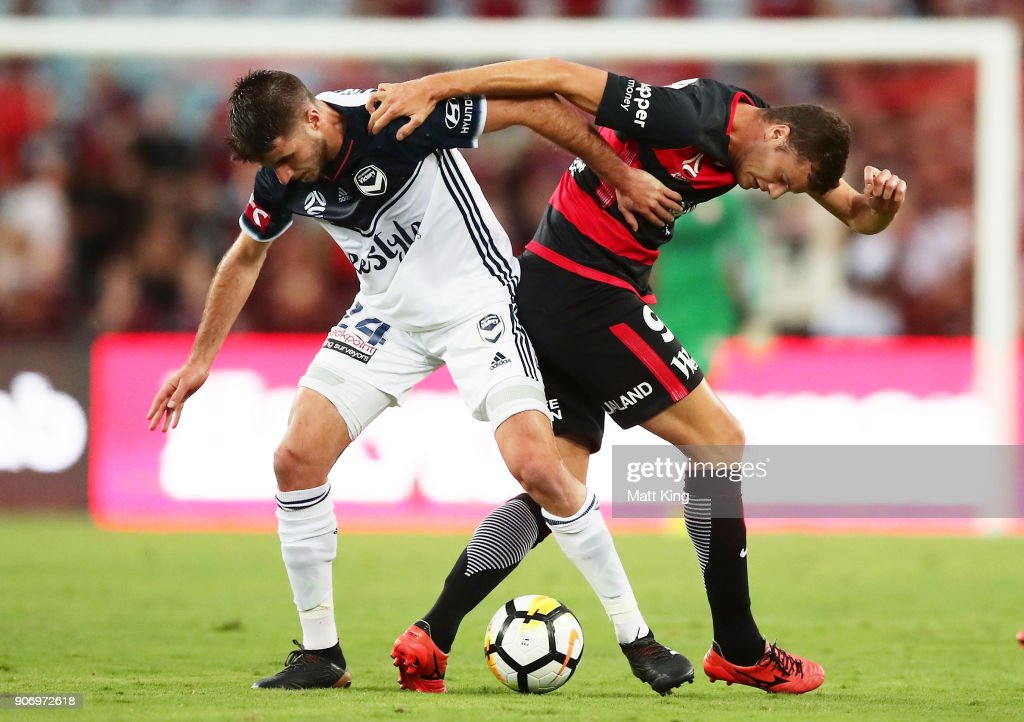 Terry Antonis of the Victory competes for the ball against Oriol Riera of the Wanderers during the round 17 A-League match between the Western Sydney Wanderers and the Melbourne Victory at ANZ Stadium on January 19, 2018 in Sydney, Australia.