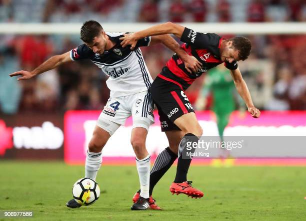 Terry Antonis of the Victory competes for the ball against Oriol Riera of the Wanderers during the round 17 ALeague match between the Western Sydney...