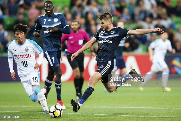 Terry Antonis of the Victory kicks the ball away from Kentaro Moriya of Kawasaki Frontale during the AFC Asian Champions League match between the...