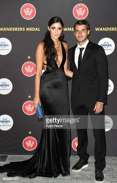 Terry Antonis of the Wanderers and partner Kristina Antonis arrive ahead of the Western Sydney Wanderers Medal Night at the International Convention...