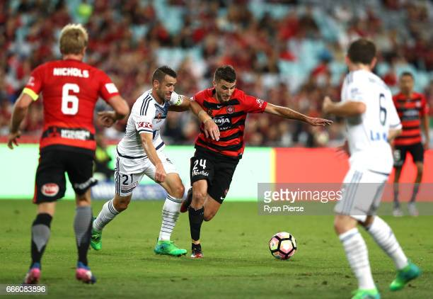 Terry Antonis of the Wanderers competes for the ball against Carl Valeri of the Victory during the round 26 ALeague match between the Western Sydney...