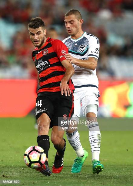 Terry Antonis of the Wanderers competes for the ball against James Troisi of the Victory during the round 26 ALeague match between the Western Sydney...