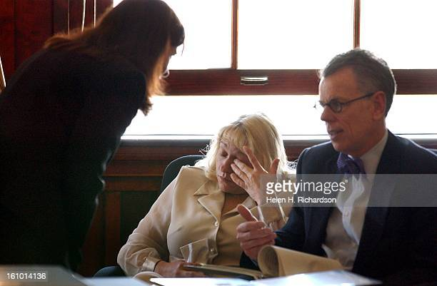 Terry Barton wipes away a tear as she consults with her lawyers Teller County Public Defender Sharleen Reynolds left and Federal Public Defender Rick...