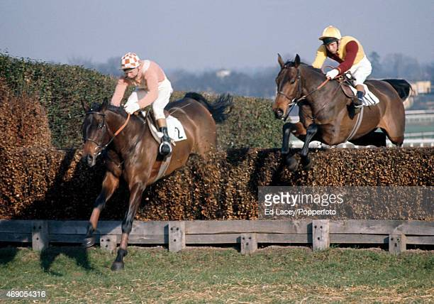 Terry Biddlecombe riding Fearless Fred leads John Cook riding Spanish Steps in the Gainsborough Chase at Sandown Park Racecourse in Esher Surrey on...