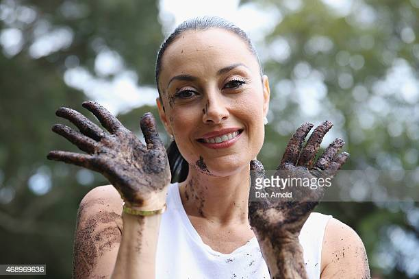 Terri Biviano poses after participating in a mud fight to raise awareness about the 'Mud Pie Project' to help raise funds to complete the Ian Potter...