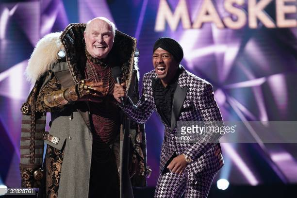 Terry Bradshaw and host Nick Cannon in the allnew Five Masks No More episode of THE MASKED SINGER airing Wednesday Jan 16 on FOX