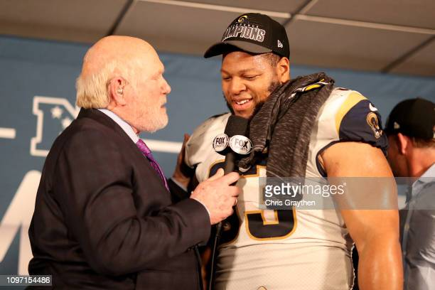 Terry Bradshaw interviews Ndamukong Suh of the Los Angeles Rams after defeating the New Orleans Saints in the NFC Championship game at the...