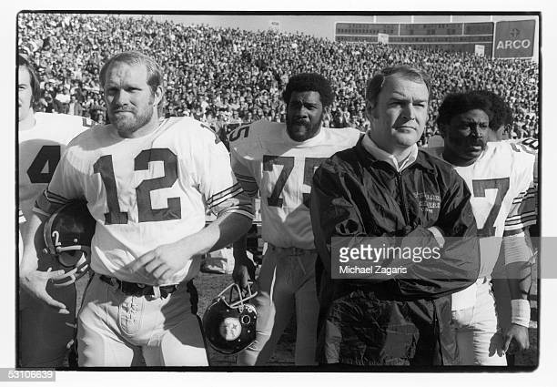 Terry Bradshaw Mean Joe Greene head coach Chuck Noll and Glen Edwards of the Pittsburgh Steelers watch from the sideline during the 1974 AFC...