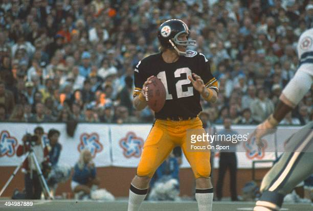 Terry Bradshaw of the Pittsburgh Steelers drops back to pass against the Dallas Cowboys during Super Bowl X on January 18 1976 at the Orange Bowl in...