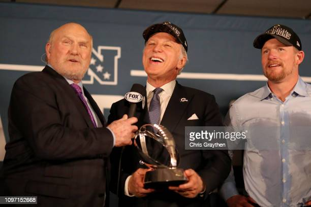 Terry Bradshaw presents Stanley Kroenke owner of the Los Angeles Rams and General Manager Les Snead the NFC Championship trophy after defeating the...