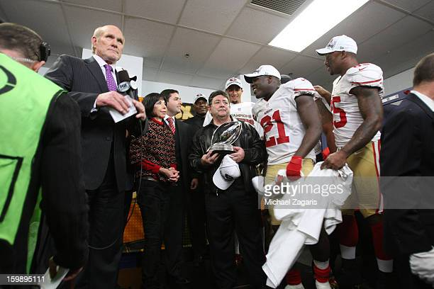 Terry Bradshaw waits to go on air for the George Halas Trophy presentation with San Francisco 49ers CoChairman Denise York CEO Jed York former owner...