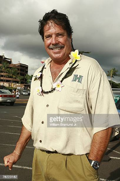Terry Brennan father of Colt Brennan of the Hawaii Warriors smiles for a photo outside Aloha Stadium before the game between the Washington Huskies...